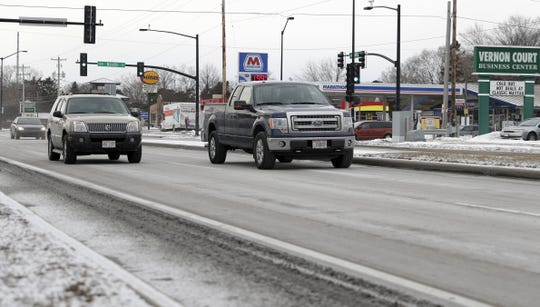 Cars drive through the intersection at Ninth Street and Military Avenue on Jan. 18, 2019 in Green Bay, Wis. Sarah Kloepping/USA TODAY NETWORK-Wisconsin