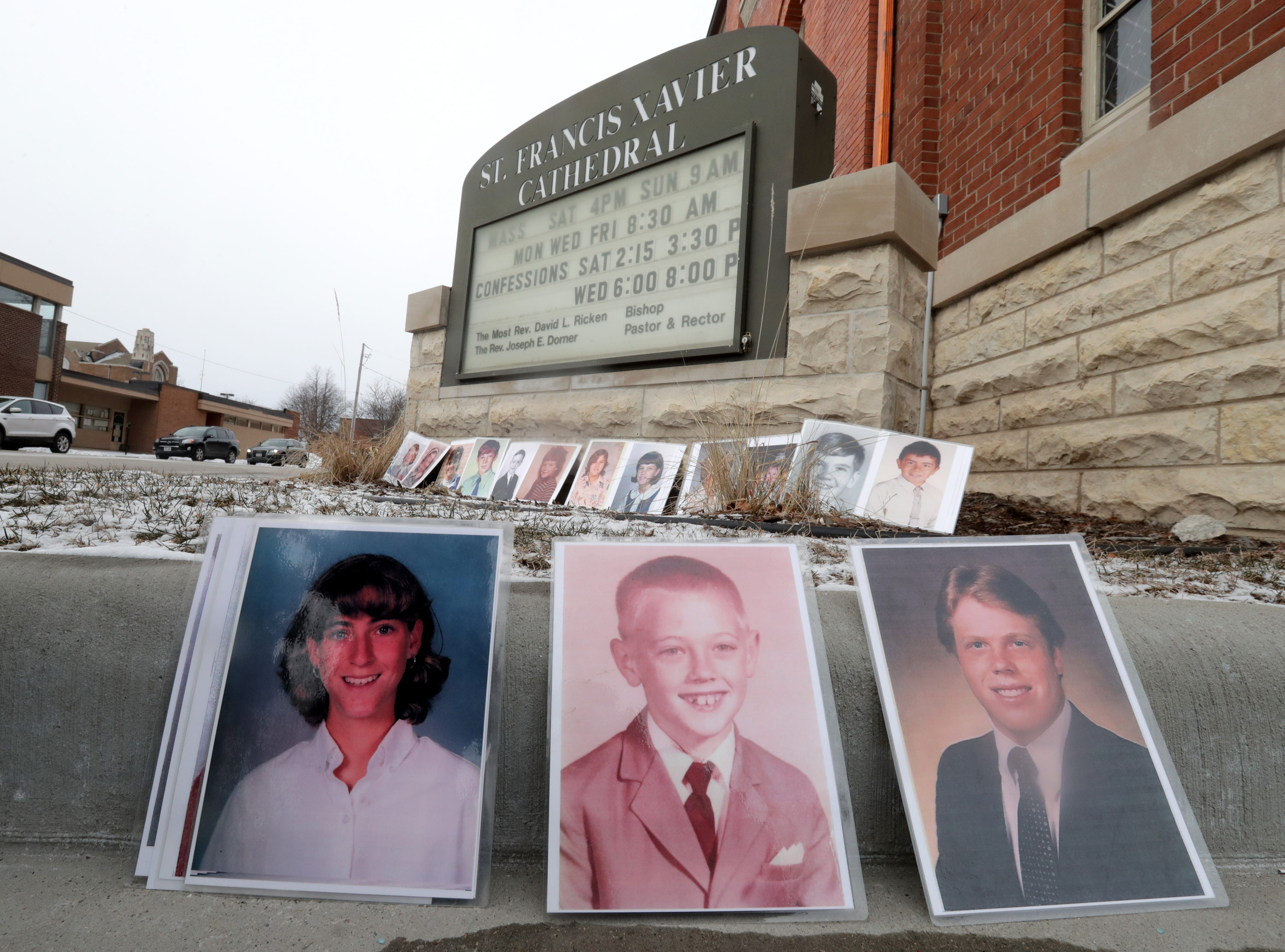 Photos of sexual abuse victims  were displayed in front of St. Francis Xavier Cathedral during a Jan. 18 press conference at which  Survivors Network for those Abused by Priests called on state Attorney General Josh Kaul to investigate the diocese's handling of allegations against its priests.