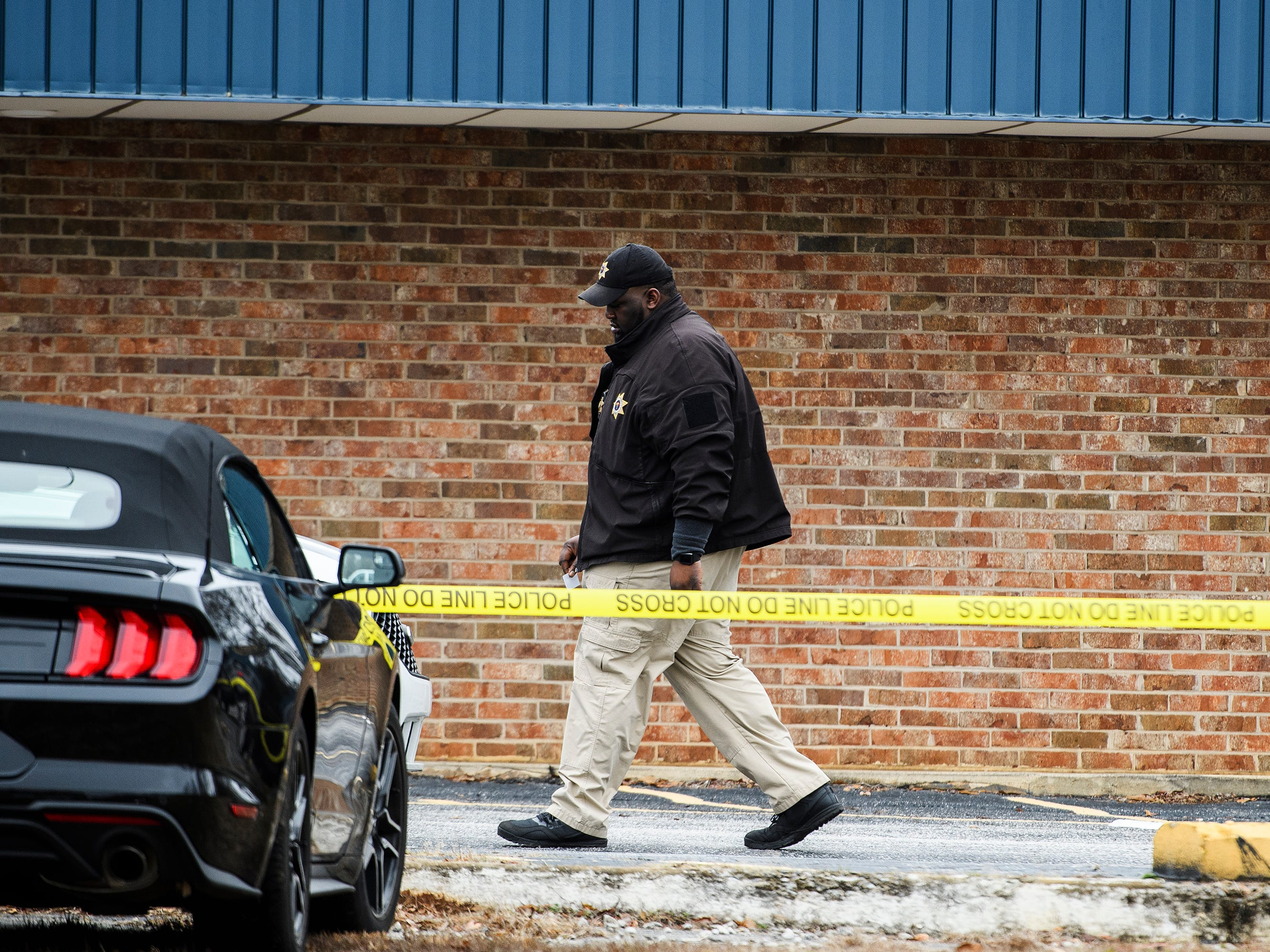Gary Sessions of the Greenville County Coroner's Office walks outside of the scene of a suicide on Monday, Jan. 14, 2019