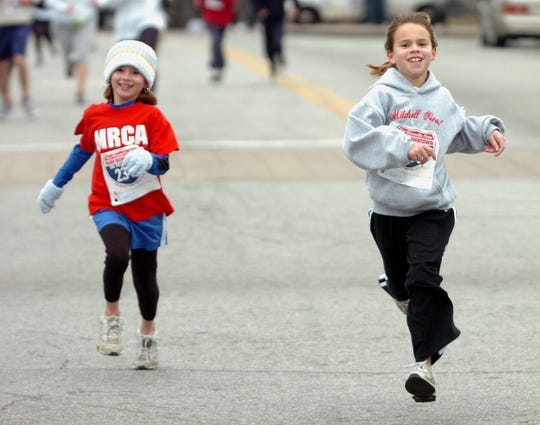 Young runners hit the street in the 2008 Greenville News Run Downtown 5K in 2008.
