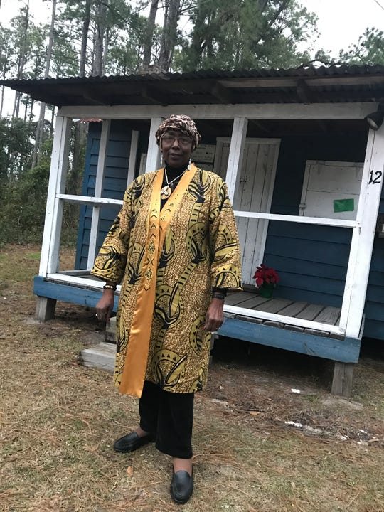 Louise Cohen stands outside her father's restored house, now called the Gullah Museum of Hilton Head Island, on January 15, 2019.