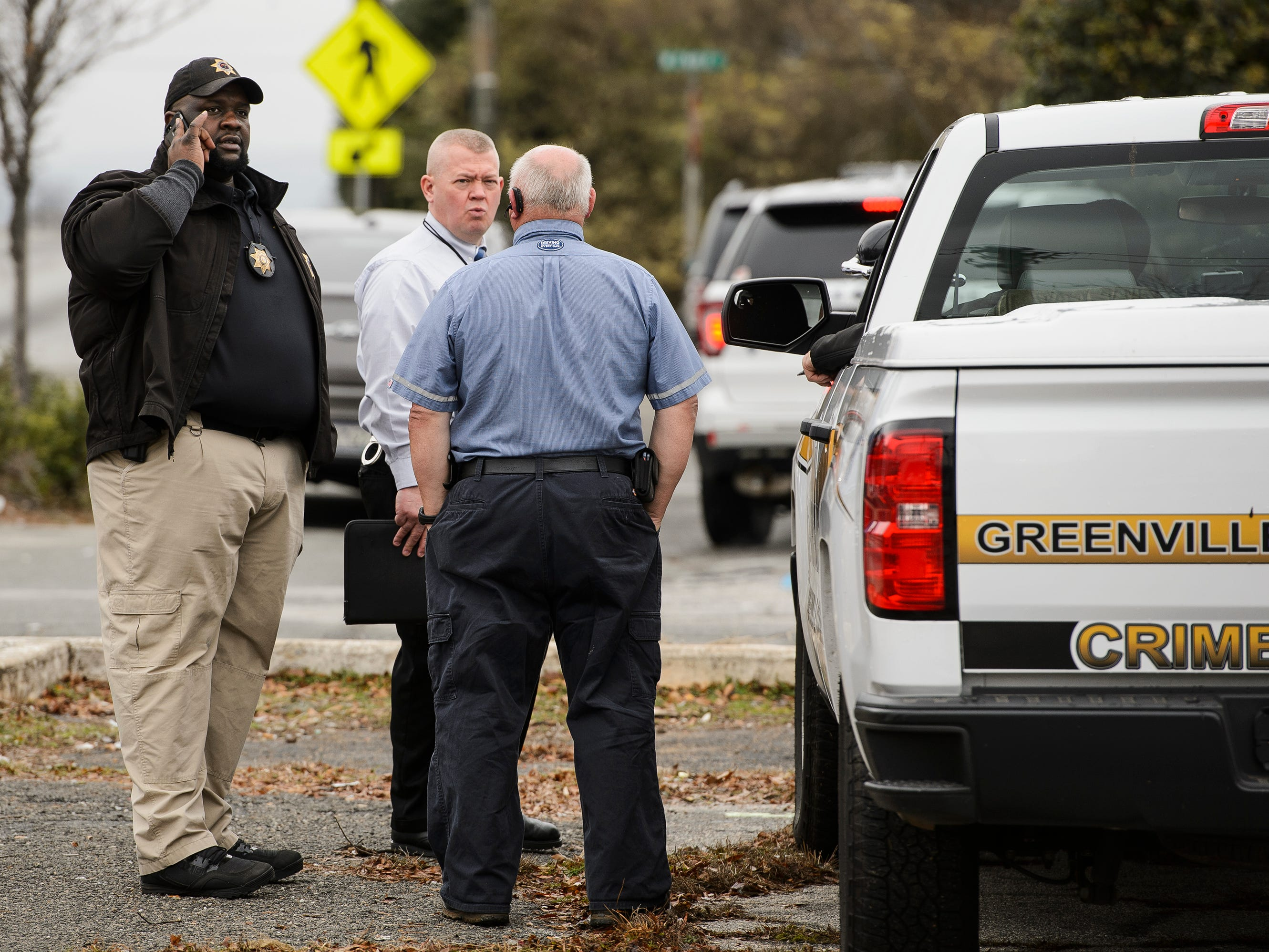 Gary Sessions of the Greenville County Coroner's Office talks on the phone outside the scene of a suicide on Monday, Jan. 14, 2019
