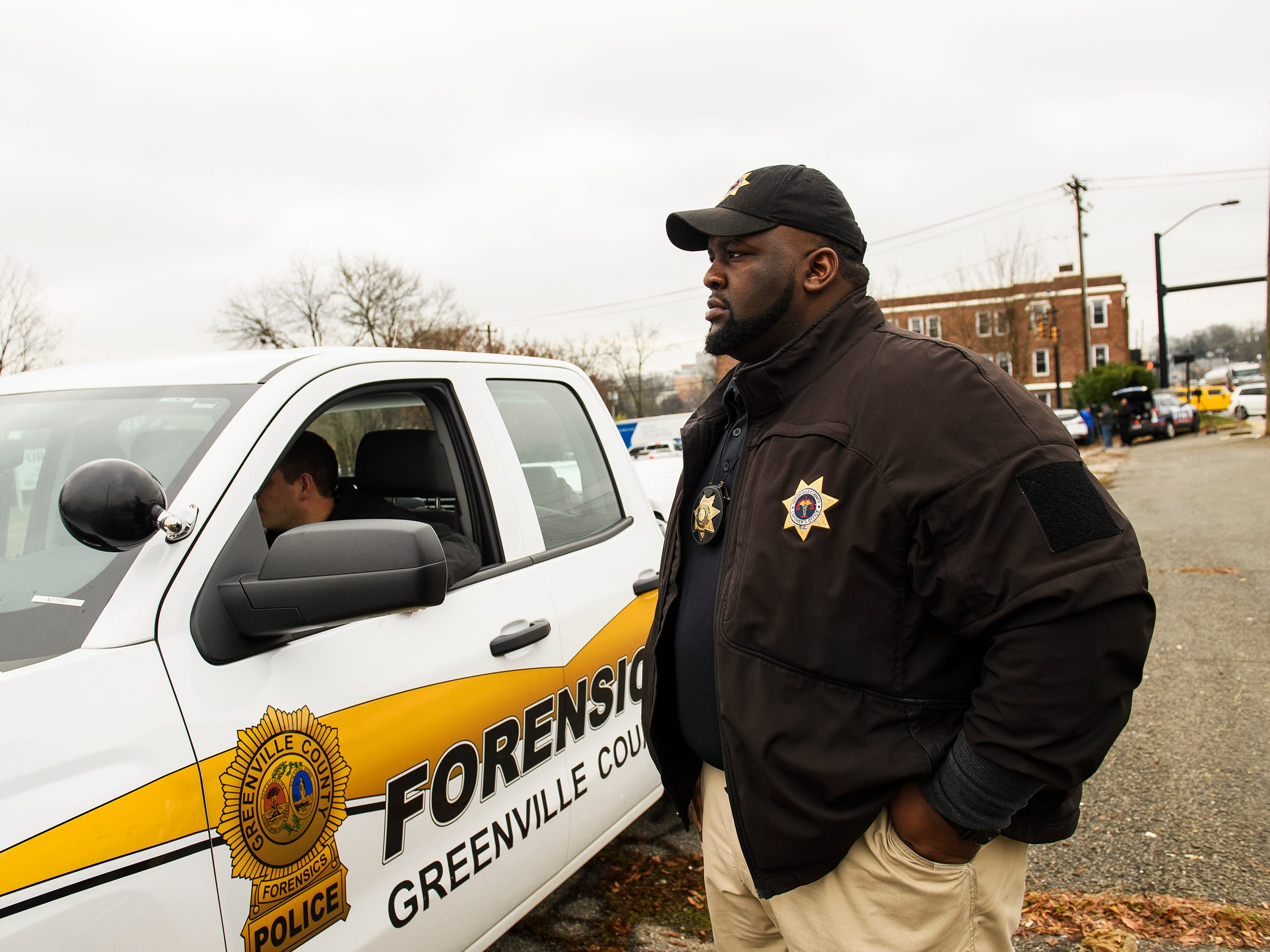 Gary Sessions of the Greenville County Coroner's Office stands outside of the scene of a suicide in Greenville on Monday, Jan. 14, 2019