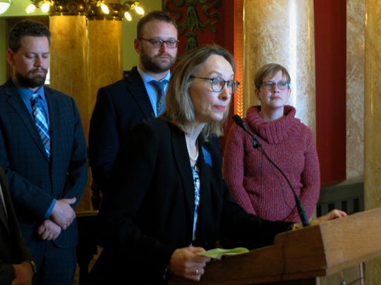 Kristen Newby, right, listens as state Rep. Mary Ann Dunwell takes a question during a news conference on Wednesday, Jan. 16, 2019, in Helena, Mont. Newby, who says she is the daughter of a former Montana high school athletic trainer accused of abusing teenage boys, says she supports a bill that would lift the statute of limitations for sex offenses against children. (AP Photo/Matt Volz)