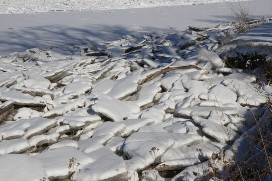 An ice jam near the shore of the Missouri River in Great Falls last month. Muddy Creek near Vaughn rose rapidly Friday and was near flood stage Saturday due to an ice jam.
