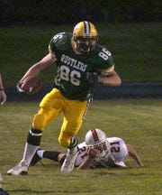 C.M. Russell star Austin Mullins runs for good yardage after catching a pass against Billings Senior in September of 2003.
