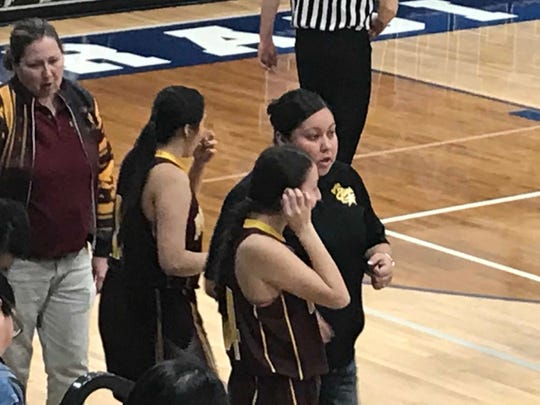 Rocky Boy girls' basketball coach Shaneen Hammond gives instructions to Kirsten LaMere to start the second half of there game in Fairfield Thursday night.