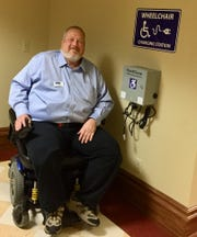 Lobbyist Joel Peden by the wheelchair charging station in the basement of the state Capitol.