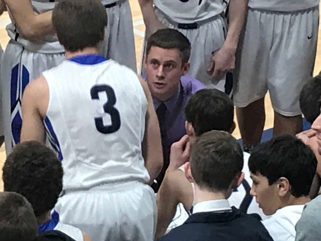 Jordan Ratliff, in purple shirt, discusses a game plan with his Fairfield Eagles in their Thursday home game against Rocky Boy.
