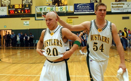 CMR teammates Austin Mullins, right, and Tony Forster are pictured following a CMR victory over Great Falls High in December of 2003.