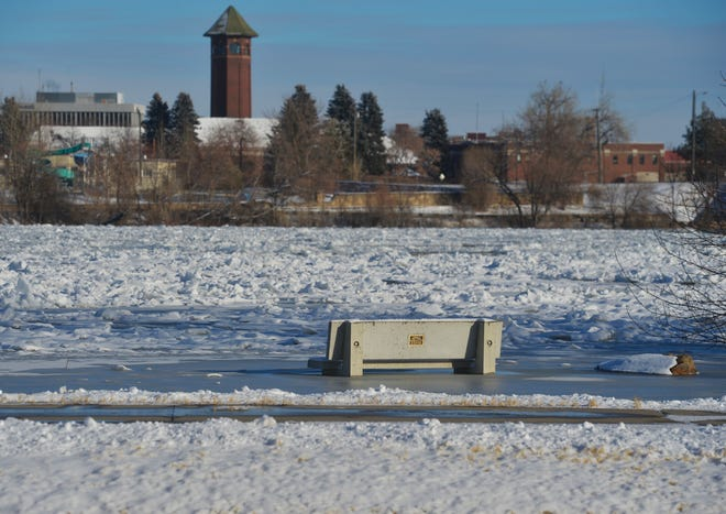The accumulation of ice on the Missouri River in Great Falls has caused minor flooding on both east and west banks of the river on Friday.  A cement bench on the west bank of the River's Edge Trail is surrounded by ice from the flooding.