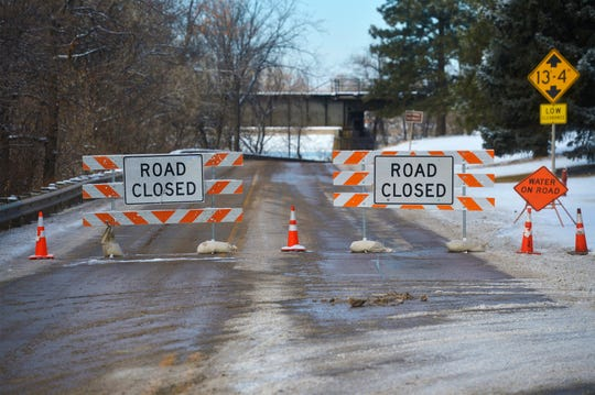 River Drive South at the train trestle is closed due to minor flooding caused by an ice jam on the Missouri River Friday.