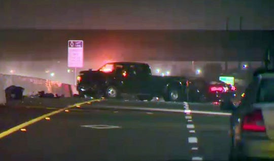 In this Tuesday, Jan. 15, 2019, image from video provided by CBS Sacramento/KOVR-TV shows the scene of a crash after deputies caught up with an alleged suspect who was driving in the area of westbound Interstate 80 near Highway 65 where he crashed into another driver near Roseville, Calif. A gunman who shot and killed a 93-year-old woman, wounded another man and then injured a police dog during a rampage was killed by deputies on the California highway, authorities said Wednesday. (CBS Sacramento/KOVR via AP)