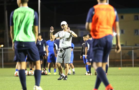 Visiting assistant instructor Tadashi Hase manages a training session with referees and the Guam U19 national training squad at the Guam Football Association National Training Center.
