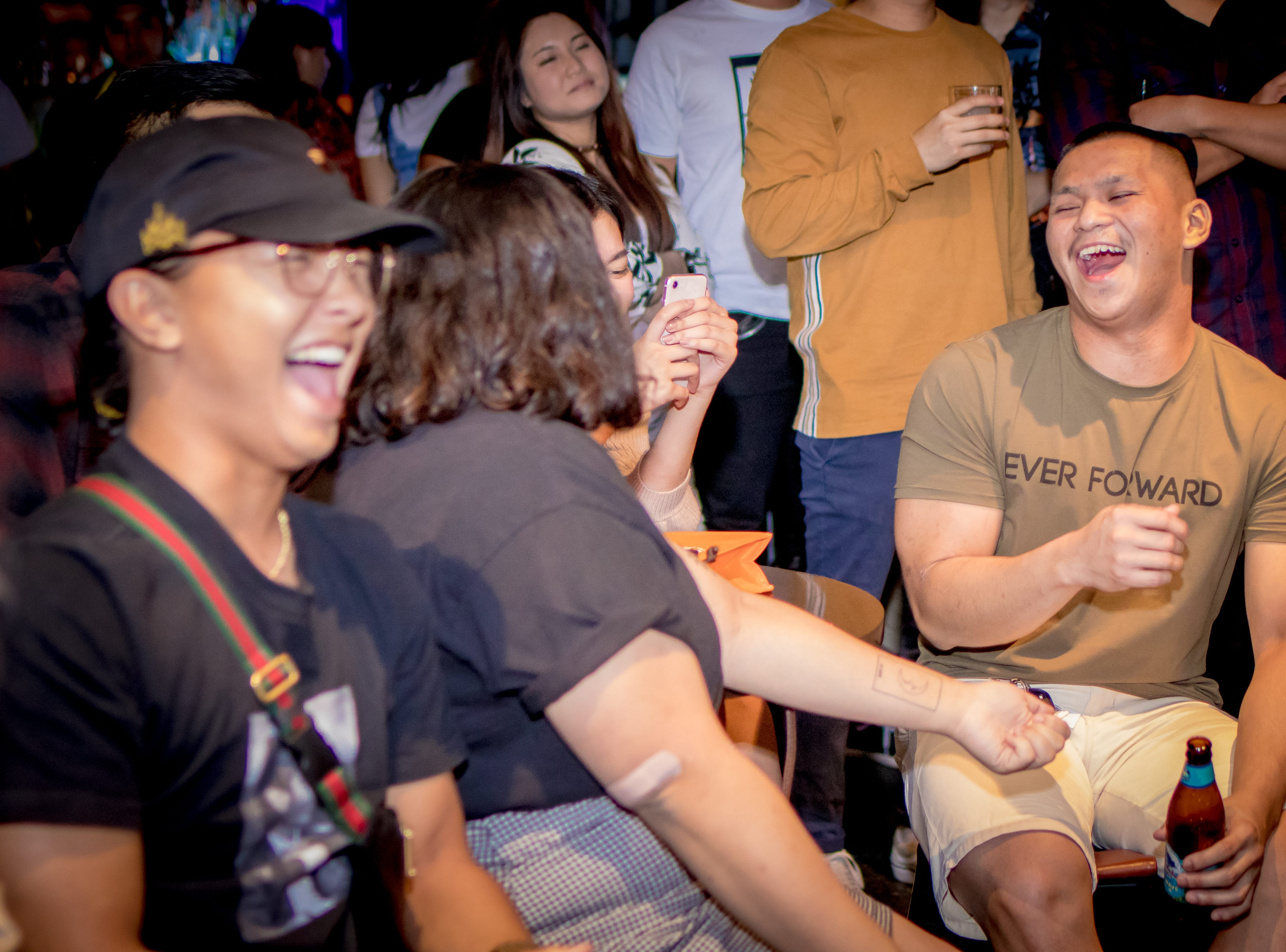 "Party goers share laughter during Local Deluxe and Fat Tofu's performance at their fundraising event ""Road to Japan"" at The Venue on January 10."