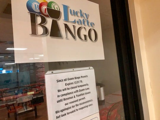 A sign posted on the glass door of Lucky Latte Bingo in Tamuning on Friday reads that it's closed temporarily until the Department of Revenue and Taxation issues them a renewed bingo operation permit.