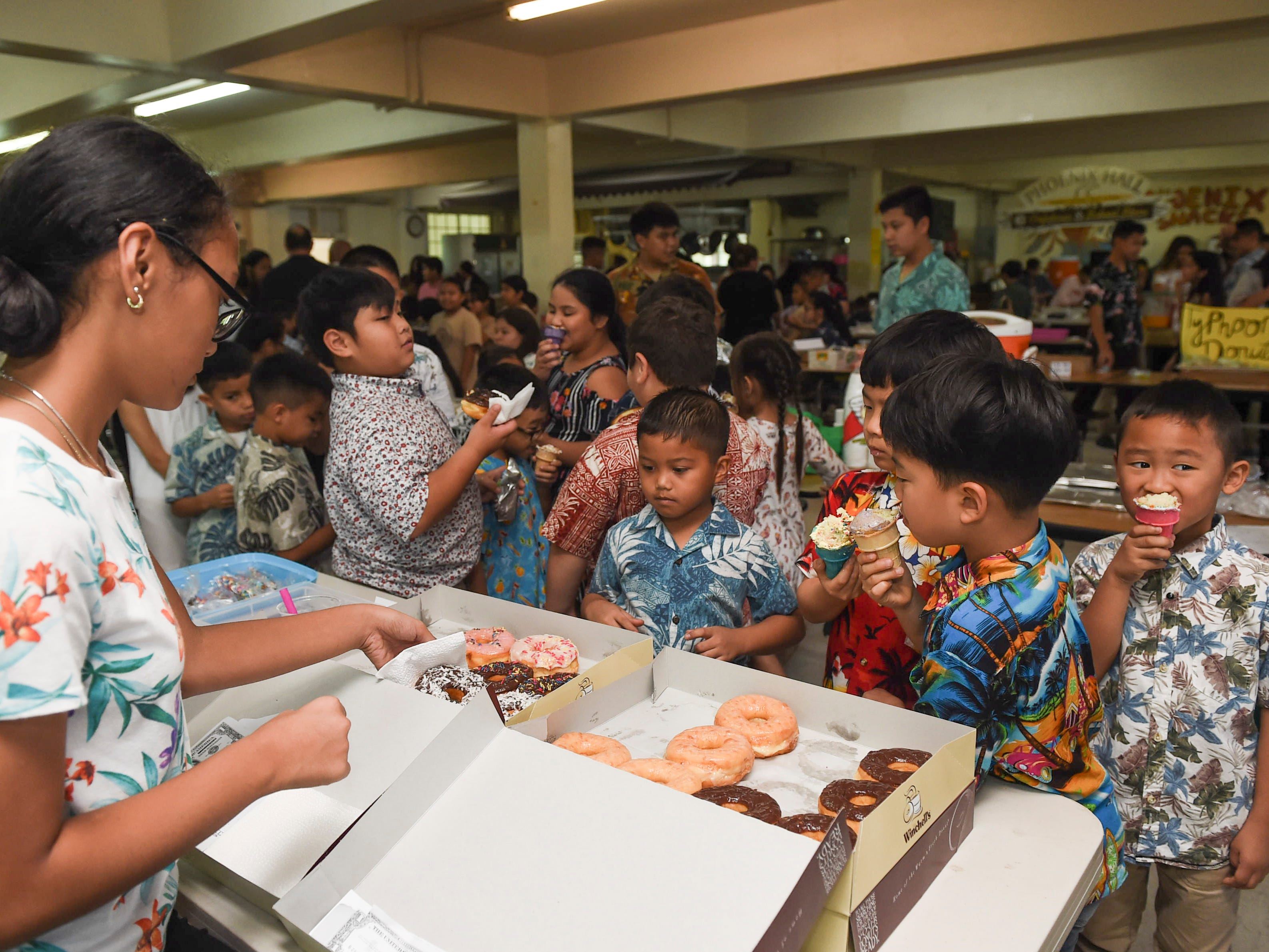 Middle school students test out their business ideas on elementary schoolers during the 5th Annual Ysrael School of Business Retail Bazaar and Entrepreneur Fair at Our Lady of Mount Carmel Catholic School in Agat, Jan. 18, 2019.