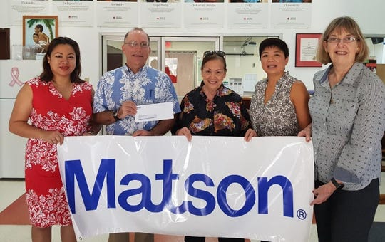 Bernie Valencia, Matson vice president and general manager for Guam and Micronesia, second from right, presents a check on behalf of Matson employees to the American Red Cross of the Northern Mariana Islands to assist with Yutu recovery efforts. From left, Marites Yumul, Matson liaison-Saipan region; John Hirsch, Red Cross director; Jean Sablan, Red Cross honorary director and board member; Valencia; and Prudy Denight, Matson account executive
