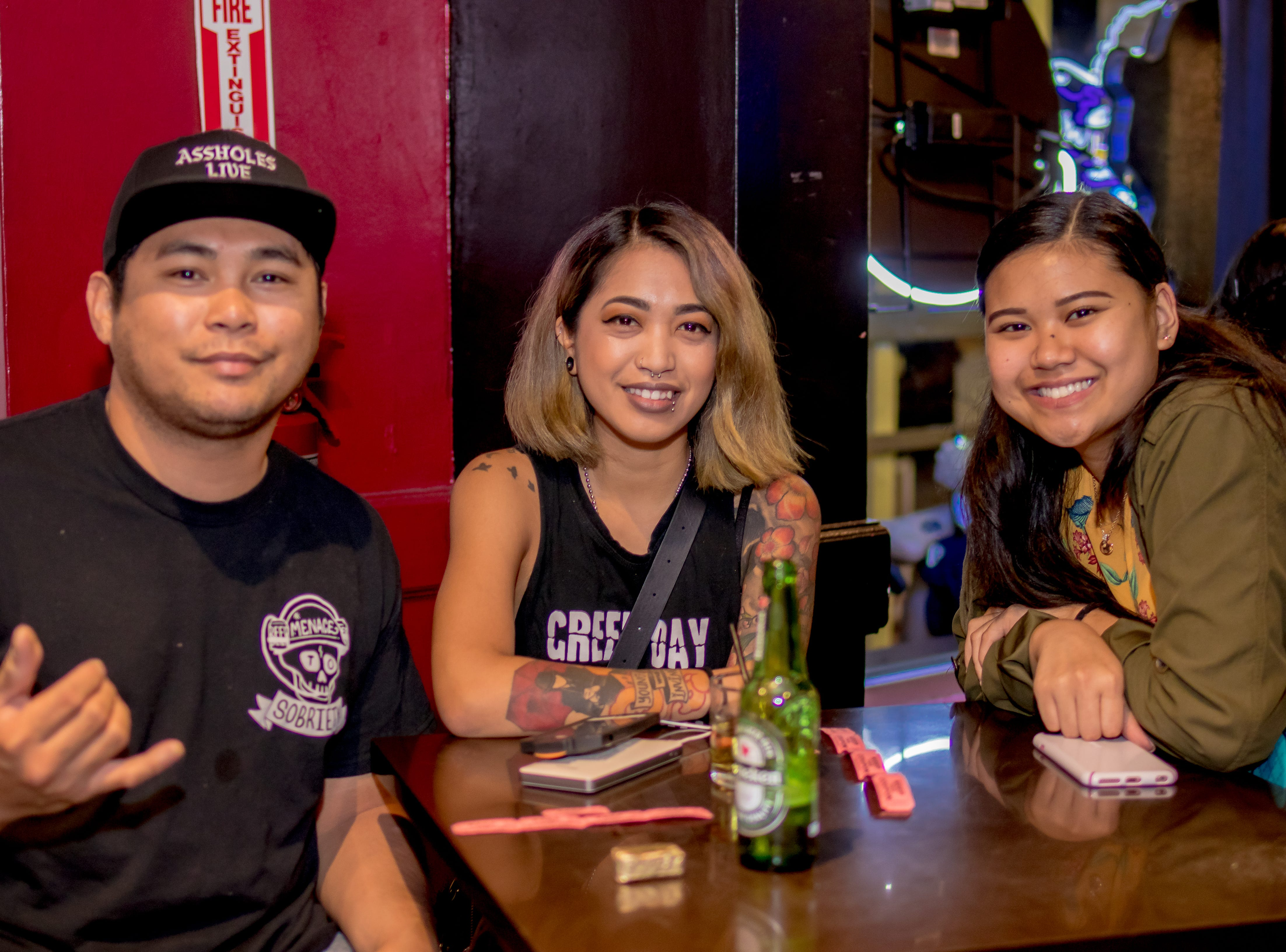 "From left, Jack Santos, Elizabeth, and Kaylee Vilasoto supporting Local Deluxe and Fat Tofu's ""Road to Japan"" fundraising event at the Venue on January 10."