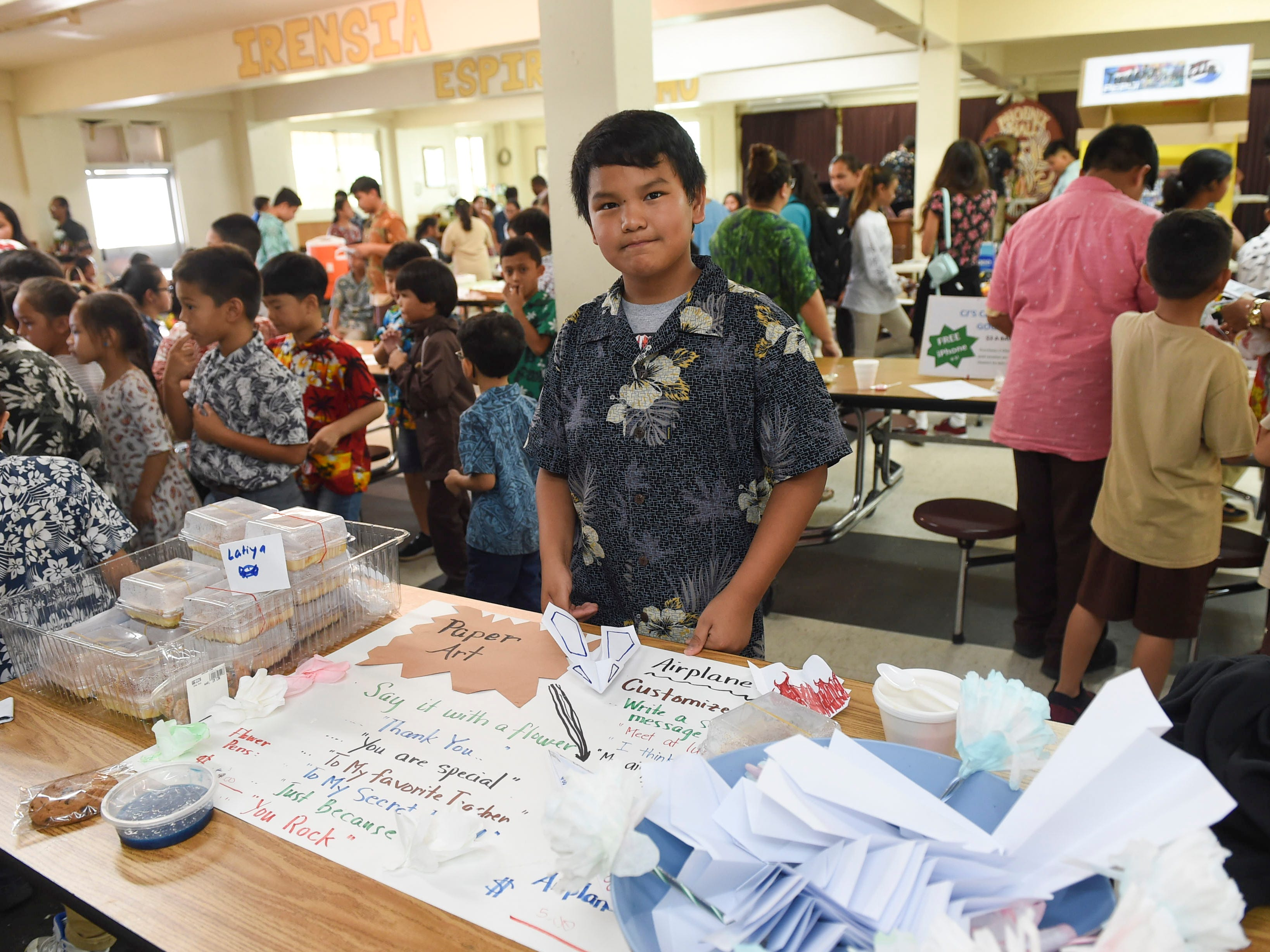 Sixth-grader Tabaaha Yellow horse, 11, at his Paper Art business stand during the 5th Annual Ysrael School of Business Retail Bazaar and Entrepreneur Fair in the Our Lady of Mount Carmel Catholic School Phoenix Hall, Jan. 18, 2019.