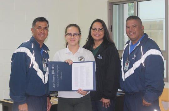 Senior Master Sergeant Victor Rosario, Air Force Junior ROTC instructor; Cadet Sophie Farrer; Dr. Barbara Adamos, JFK principal and Master Sergeant Joe Mafnas, Air Force Junior ROTC instructor.