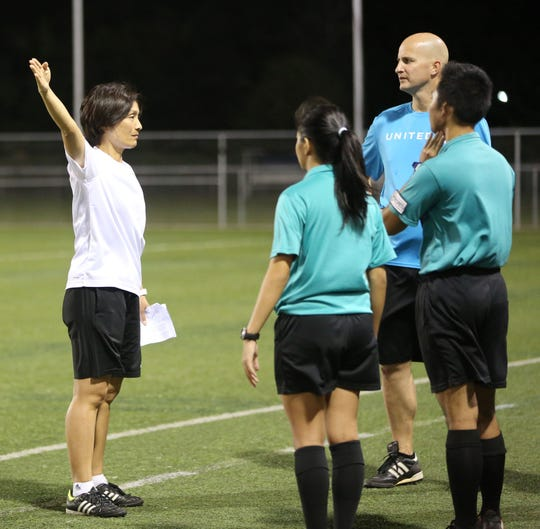 Sachiko Yamagishi, demonstrates proper referee posture during a training session at the Guam Football Association National Training Center.