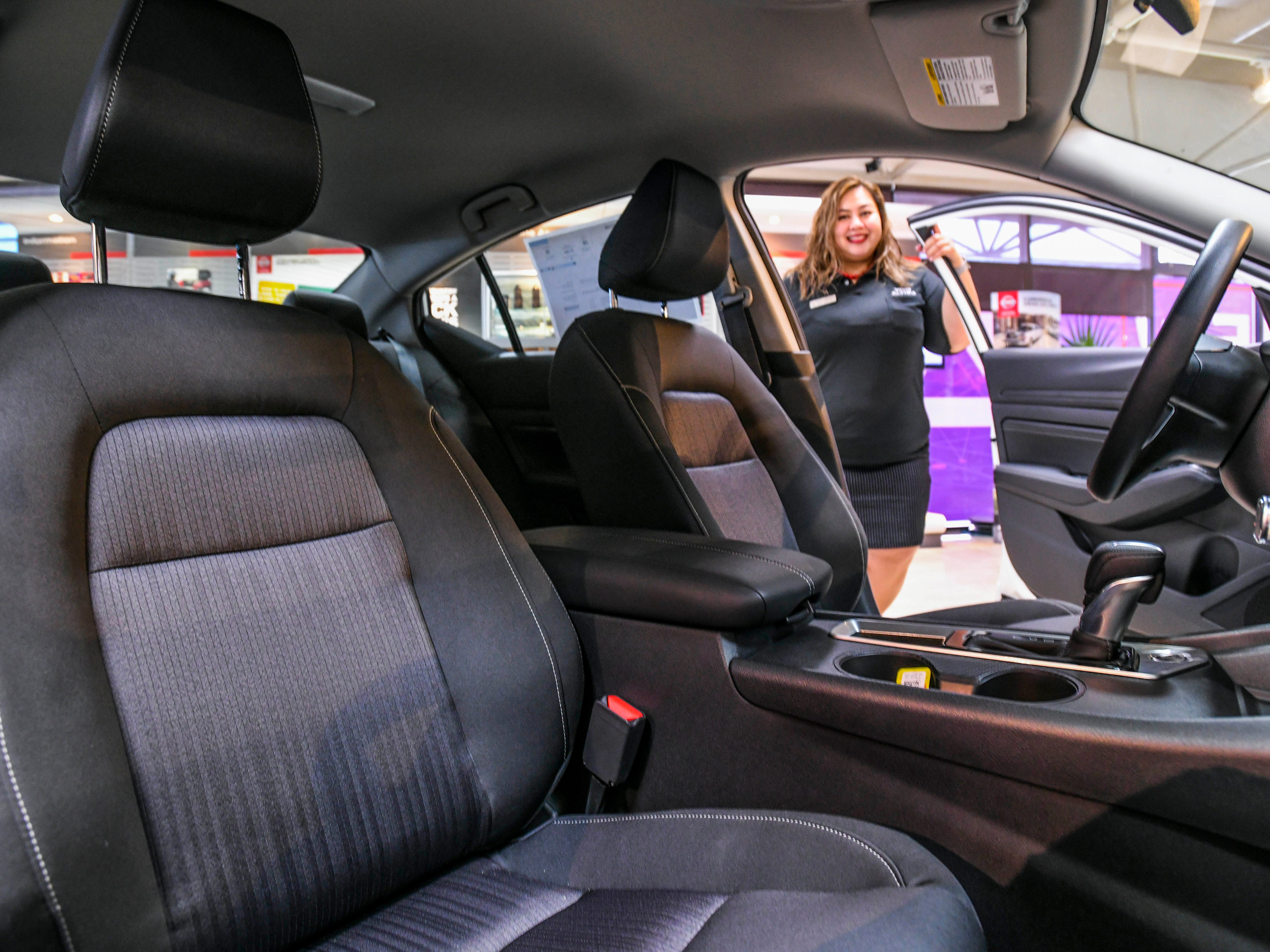 Nissan Guam Sales Consultant Marie Pilar Cruz offers a glance of the enhanced NASA-inspired Zero Gravity front seats that could be found in the redesigned 2019 Nissan Altima while at the dealership's showroom in upper Tumon on Friday, Jan. 18, 2019.