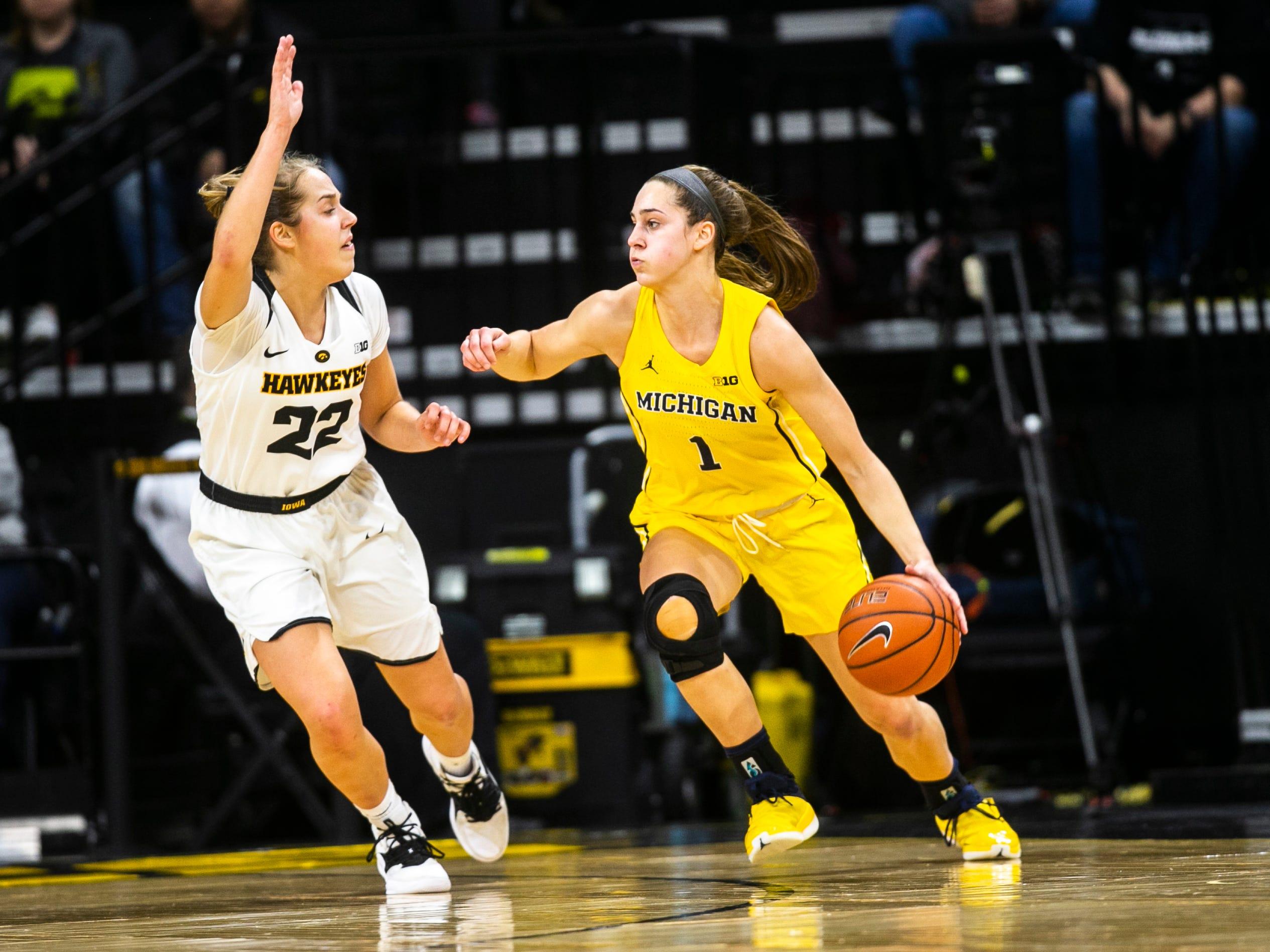 Iowa guard Kathleen Doyle (22) defends Michigan guard Amy Dilk (1) during a NCAA Big Ten Conference women's basketball game on Thursday, Jan. 17, 2019, at Carver-Hawkeye Arena in Iowa City, Iowa.