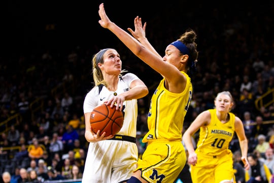 Iowa guard Makenzie Meyer (3) attempts a basket while being defended by Michigan forward Hailey Brown (15) during a NCAA Big Ten Conference women's basketball game on Thursday, Jan. 17, 2019, at Carver-Hawkeye Arena in Iowa City, Iowa.
