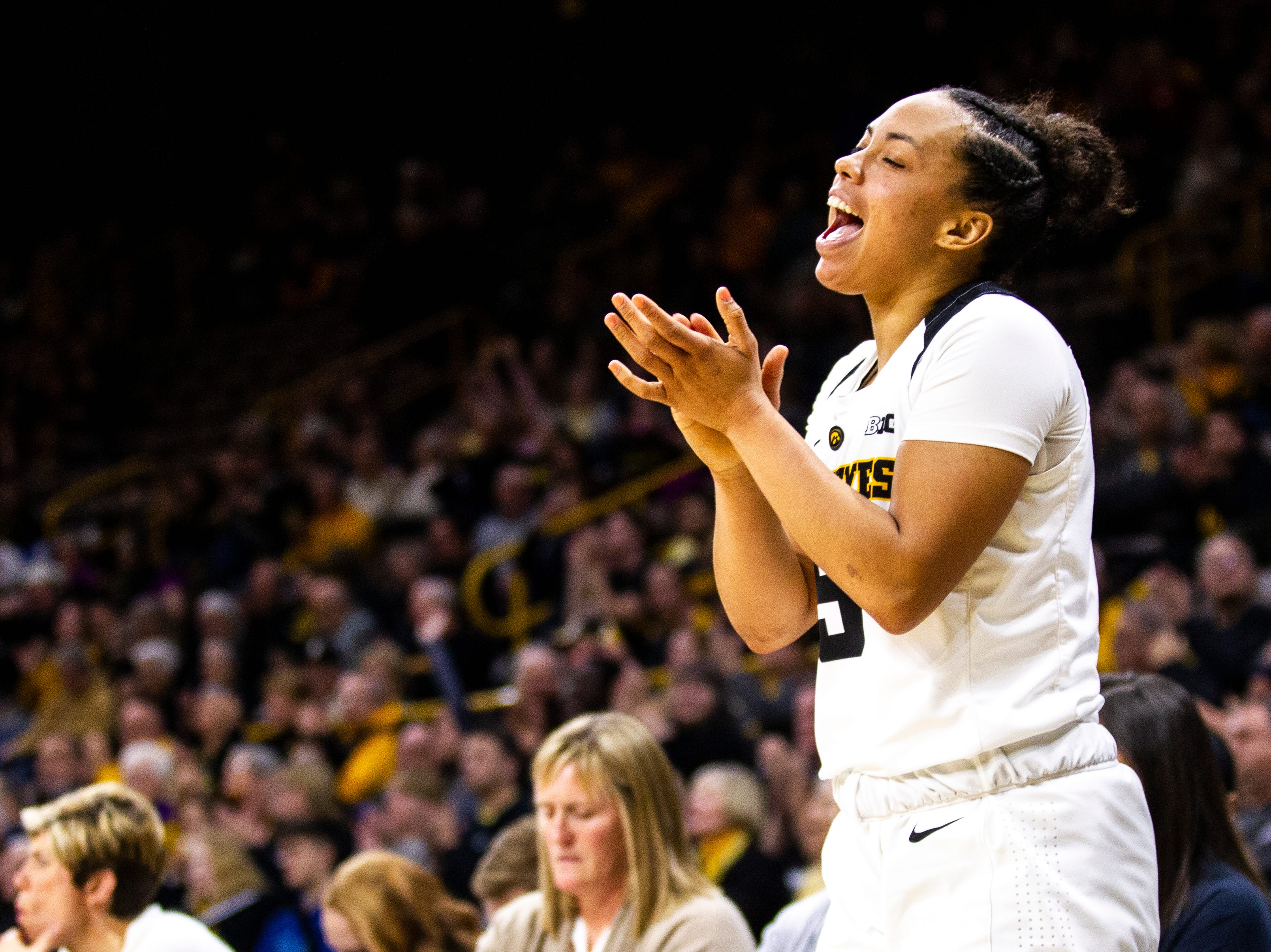 Iowa guard Alexis Sevillian (5) celebrates from the bench during a NCAA Big Ten Conference women's basketball game on Thursday, Jan. 17, 2019, at Carver-Hawkeye Arena in Iowa City, Iowa.