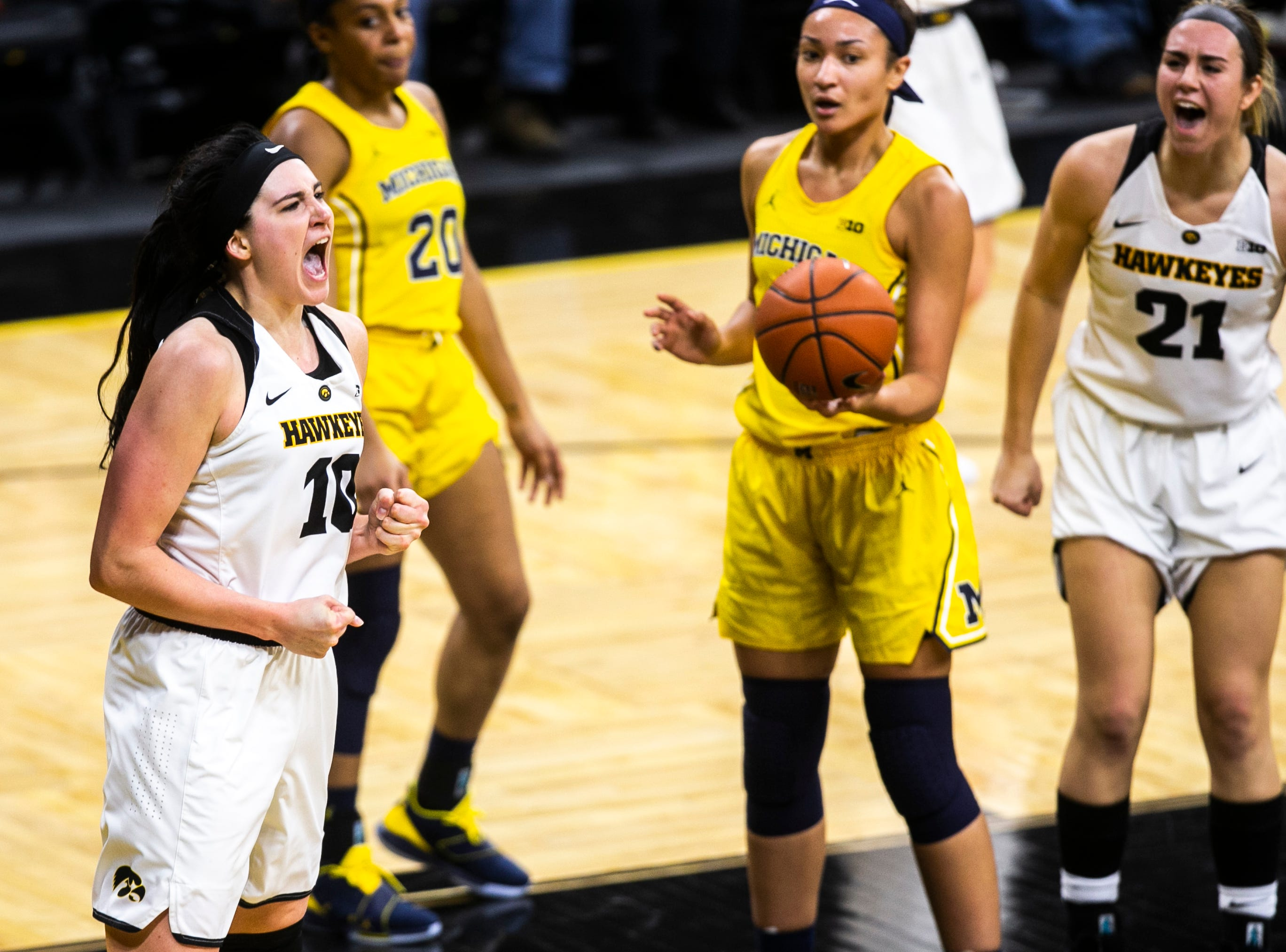 Iowa forward Megan Gustafson (10) celebrates after drawing a foul during a NCAA Big Ten Conference women's basketball game on Thursday, Jan. 17, 2019, at Carver-Hawkeye Arena in Iowa City, Iowa.