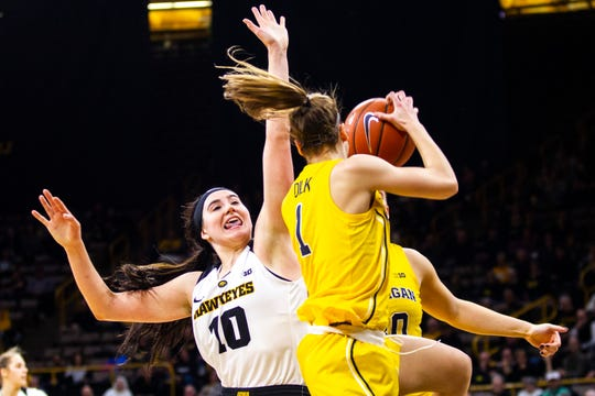 Michigan guard Amy Dilk (1) comes down with a rebound past Iowa forward Megan Gustafson (10) during a NCAA Big Ten Conference women's basketball game on Thursday, Jan. 17, 2019, at Carver-Hawkeye Arena in Iowa City, Iowa.