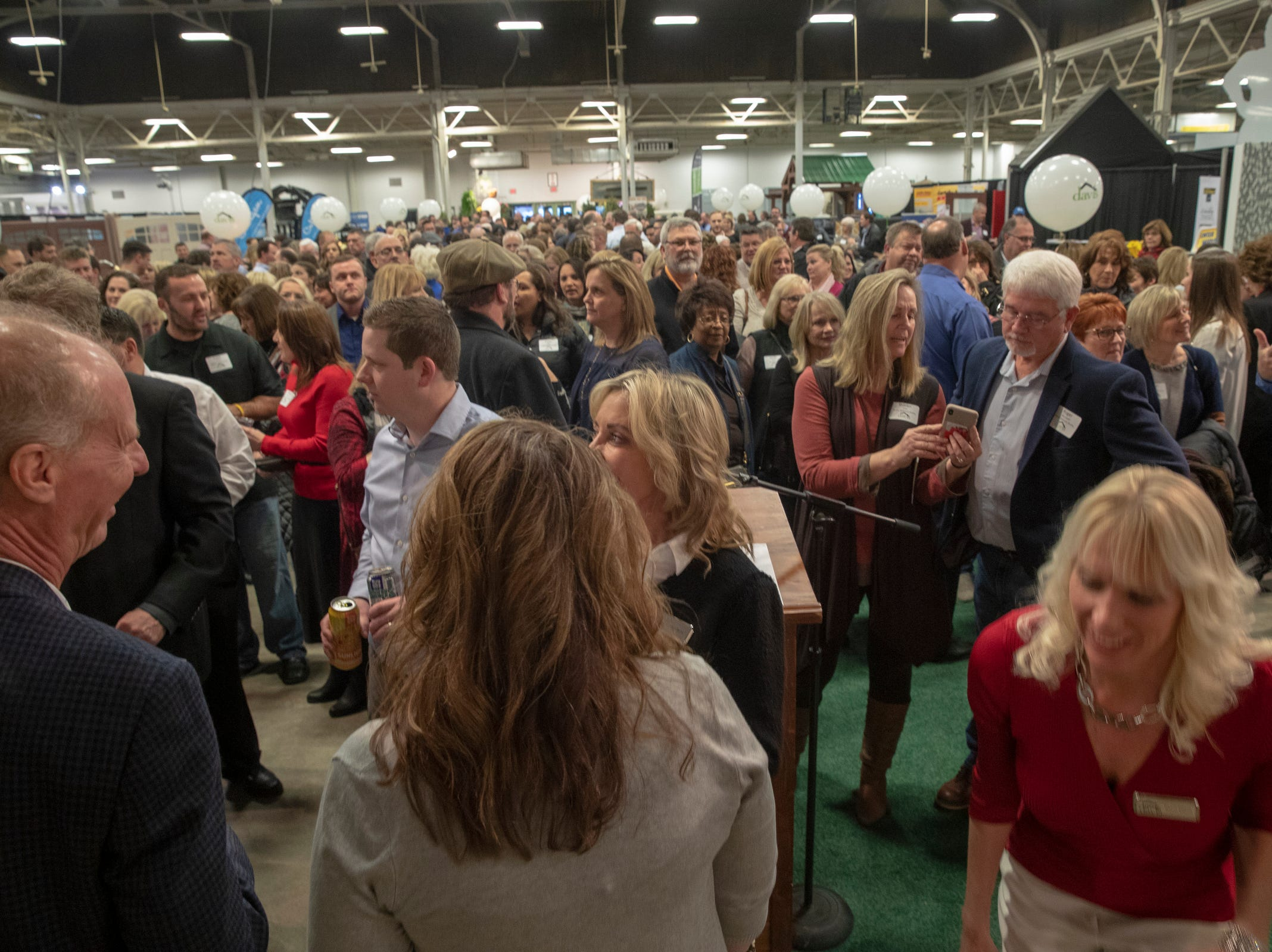 Realtors, designers and staff wait for the opening of the Centerpiece Home at the Indianapolis Home Show, Indiana State Fairgrounds, Indianapolis, Thursday, Jan. 17, 2018. The home, which is open through January 27 was built by Davis Homes, with an interior designed by Shelby Upchurch of Luxe Home Interiors, and landscaping by Calvin Landscape.