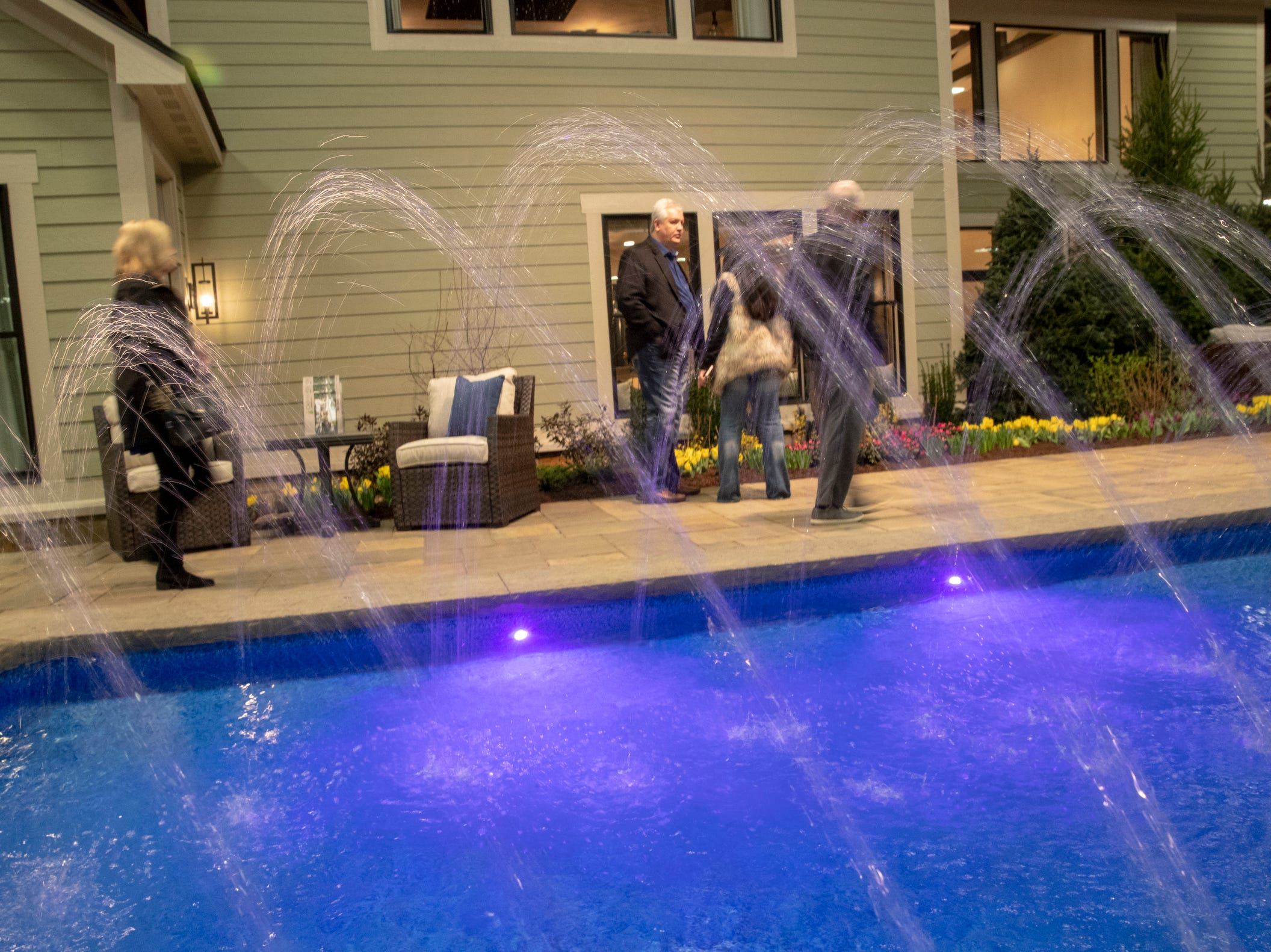 The backyard pool at the Centerpiece Home at the Indianapolis Home Show, Indiana State Fairgrounds, Indianapolis, Thursday, Jan. 17, 2018. The home, which is open through January 27 was built by Davis Homes, with an interior designed by Shelby Upchurch of Luxe Home Interiors, and landscaping by Calvin Landscape.