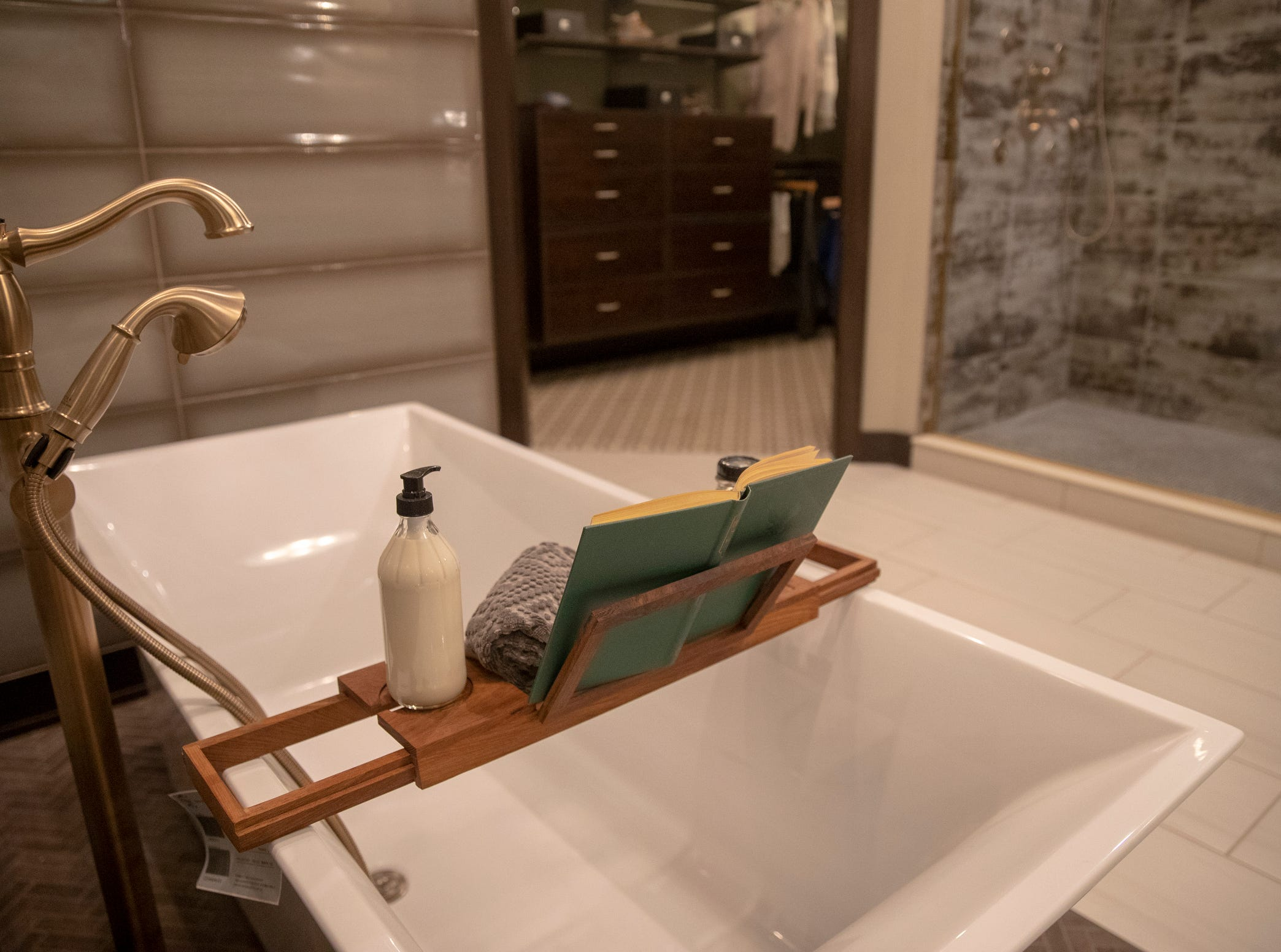 A free-standing tub inside the Centerpiece Home at the Indianapolis Home Show, Indiana State Fairgrounds, Indianapolis, Thursday, Jan. 17, 2018. The home, which is open through January 27 was built by Davis Homes, with an interior designed by Shelby Upchurch of Luxe Home Interiors, and landscaping by Calvin Landscape.