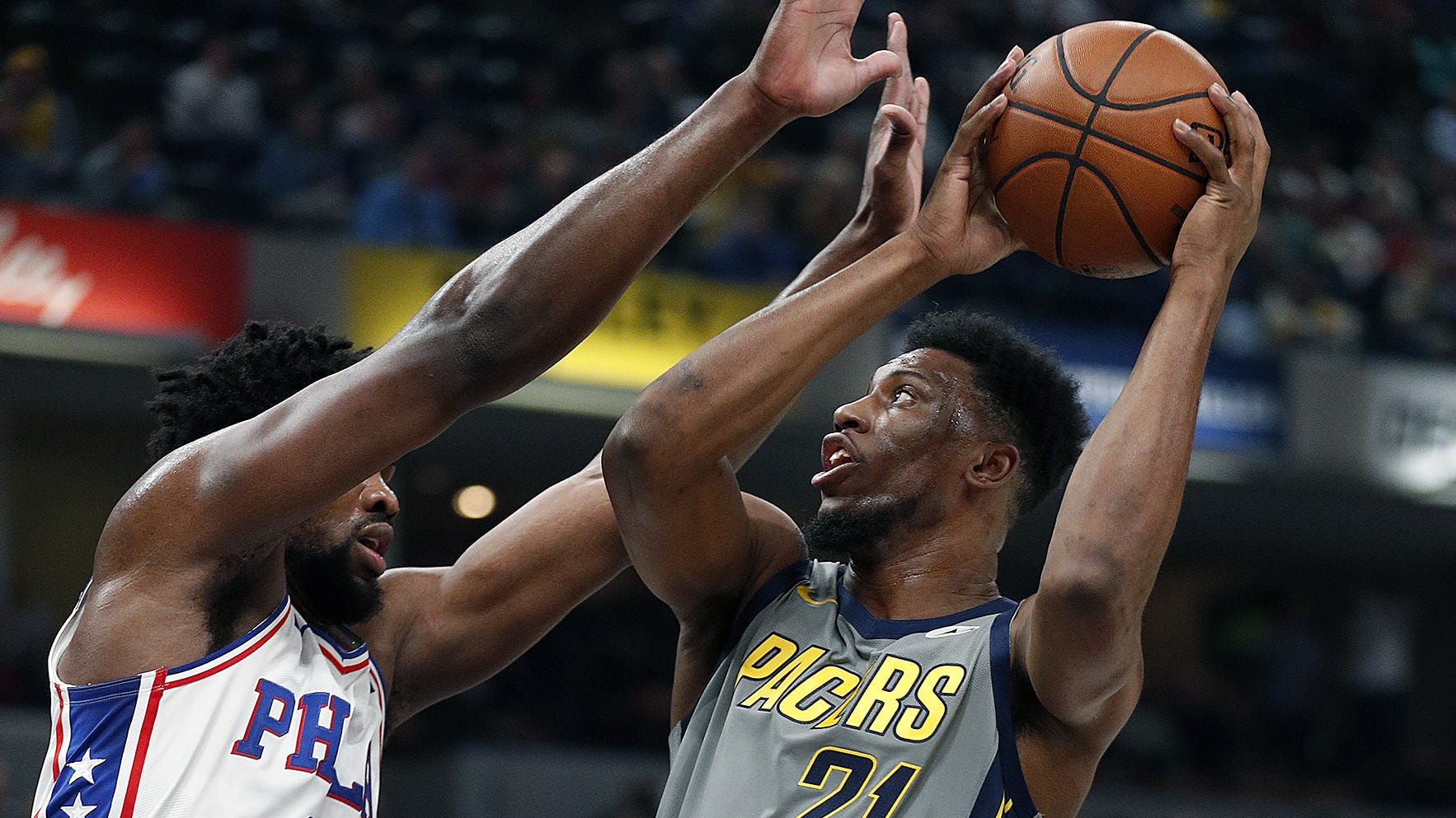 Indiana Pacers forward Thaddeus Young (21) shoots over Philadelphia 76ers center Joel Embiid (21) in the first half of their game at Bankers Life Fieldhouse on Thursday, Jan. 17, 2019.