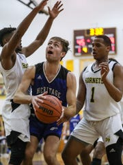 Heritage Christian Eagles Harrison Eckel (13) boxes out defenders to take a shot in the second half of City tournament quarterfinals at Howe High School in Indianapolis, Thursday, Jan. 17, 2019. Howe defeated Heritage Christian in overtime, 69-61.