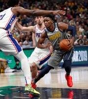 Indiana Pacers guard Victor Oladipo (4) looks to drive on Philadelphia 76ers center Joel Embiid (21) in the first half of their game at Bankers Life Fieldhouse on Thursday, Jan. 17, 2019.