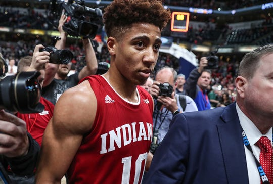 Hoosiers Rob Phinisee (10) leaves the court after he hit a three-point shot at the buzzer to defeat Butler in the Crossroads Classic, at Bankers Life Fieldhouse in Indianapolis,, Dec. 15, 2018.