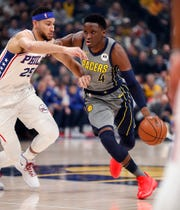 Indiana Pacers guard Victor Oladipo (4) drives on Philadelphia 76ers guard Ben Simmons (25) in the first half of their game at Bankers Life Fieldhouse on Thursday, Jan. 17, 2019.