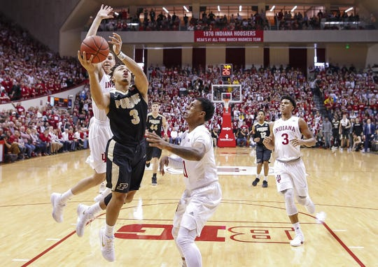 Purdue Boilermakers guard Carsen Edwards (3) shoots the ball against Indiana Hoosiers guard Devonte Green (11) Simon Skjodt Assembly Hall in Bloomington, Ind., on Wednesday, Jan. 28, 2018. (Michael Hickey for The Star)