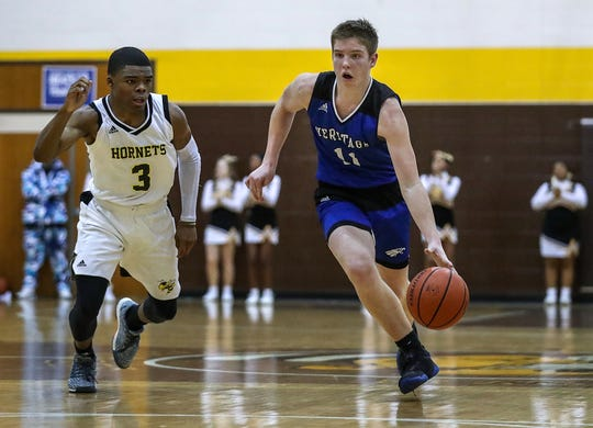 Heritage Christian Eagles Andrew Williams (11) works a possession in overtime of City tournament quarterfinals at Howe High School in Indianapolis, Thursday, Jan. 17, 2019. Howe defeated Heritage Christian in overtime, 69-61.