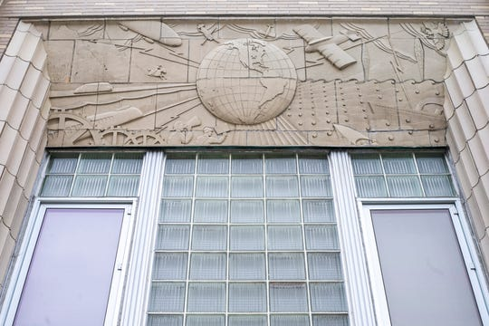 A bas-relief frieze is seen above the two-story glass entryway of Citizen Building Apartments on Friday, Jan. 18, 2019, at 319 East Washington Street in Iowa City, Iowa. The building was designed by Kruse & Klein Moderne with consulting from Henry L. Fisk and originally housed the Iowa City Press-Citizen newsroom.