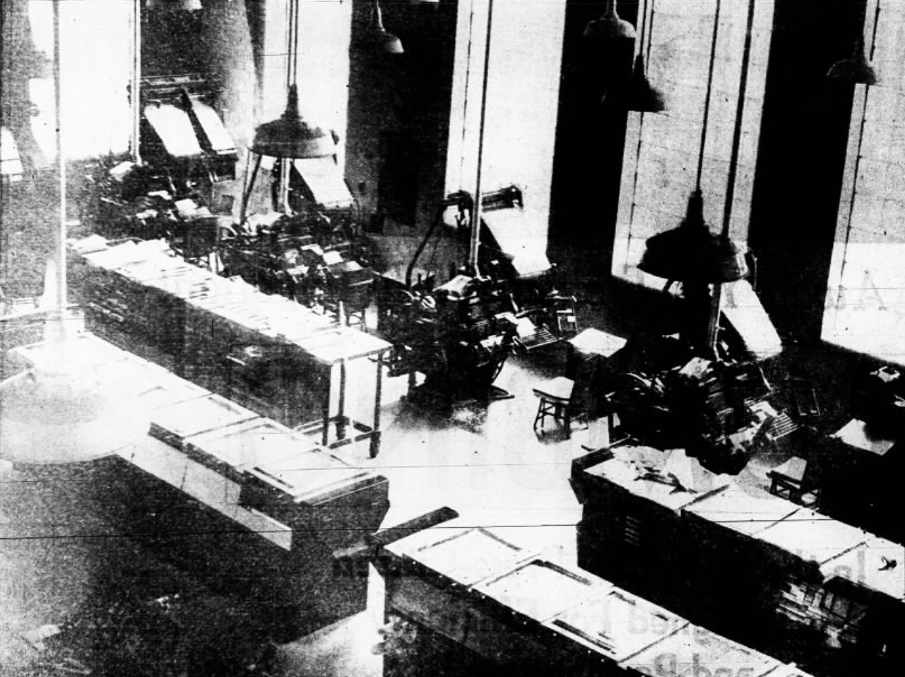 """This 1937 file photo originally was published with the caption, """"Through the lookout, perhaps the most interesting place in the new Press-Citizen building to the visitor is the vantage point on the balcony above the lobby where, through large soundproof windows, he may watch the north wall of the shop and look out on the top of the press. When the mechanical department is in full operation, the visitor may watch the speed and accurate precision which characterizes the work in this room and get a bird's eye view of the co-ordination of all the professes through which news must go from the time it leaves the editorial room until it appears on the printed page, ready for the reader,"""" at the Press-Citizen offices on Washington Street in Iowa City, Iowa."""