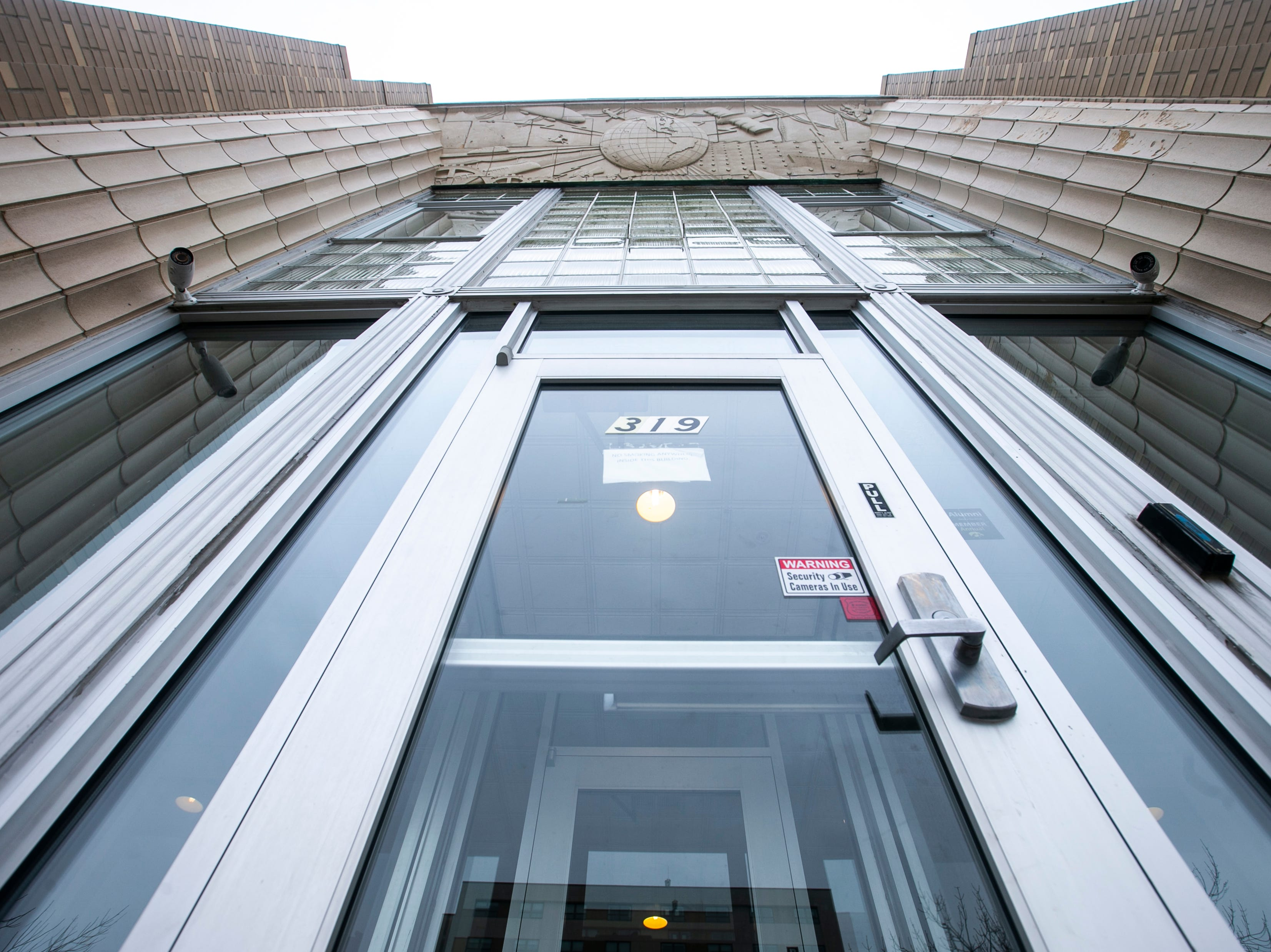 Columns are reflected in the two-story glass entryway of Citizen Building Apartments on Friday, Jan. 18, 2019, at 319 East Washington Street in Iowa City, Iowa. The building was completed in 1937 and housed the Iowa City Press-Citizen newsroom until 1991 when it moved to a new building on North Dodge Street.