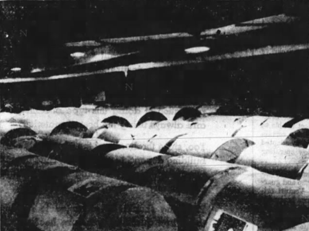"""This 1937 file photo originally was published with the caption, """"Paper storage, a large portion of the basement in the new Press-Citizen building is utilized as a storage space for newsprint. The large rolls of paper are unloaded on the platform in an area which will store two and one-half carloads of paper when the roll are laid flat and six carloads of paper when the huge rolls are set on end. The paper storage room is located across a portion of the front end of the basement and adjacent to the sub-structure of the press which facilities moving the large rolls to their positions on the press,"""" at the Press-Citizen offices on Washington Street in Iowa City, Iowa."""