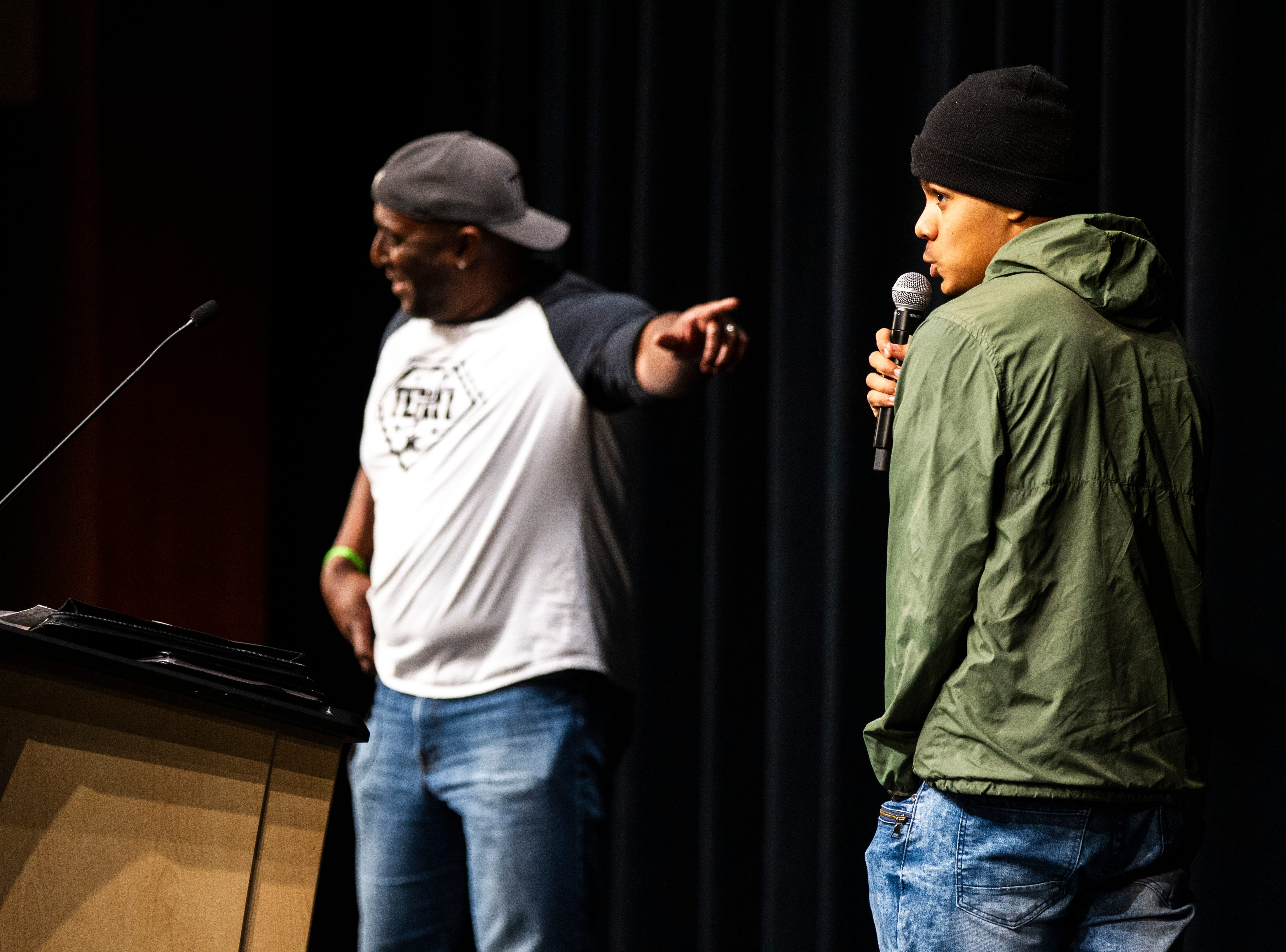 Liberty sophomore Quincy Jagnow, right, introduced Harvie Herrington during an MLK day event on Friday, Jan. 18, 2019, at Liberty High School in North Liberty, Iowa.