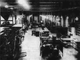 """This 1937 file photo originally was published with the caption, """"A view of the production department of the Press-Citizen is seen from the west end looking toward the composing section and line casting machines,"""" at the Press-Citizen offices on Washington Street in Iowa City, Iowa."""