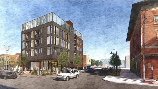 A conceptual design for the new five-story mixed-use development at 202 N. Linn St. is shown facing east in Iowa City's Northside District. Design by Neumann Monson Architects.