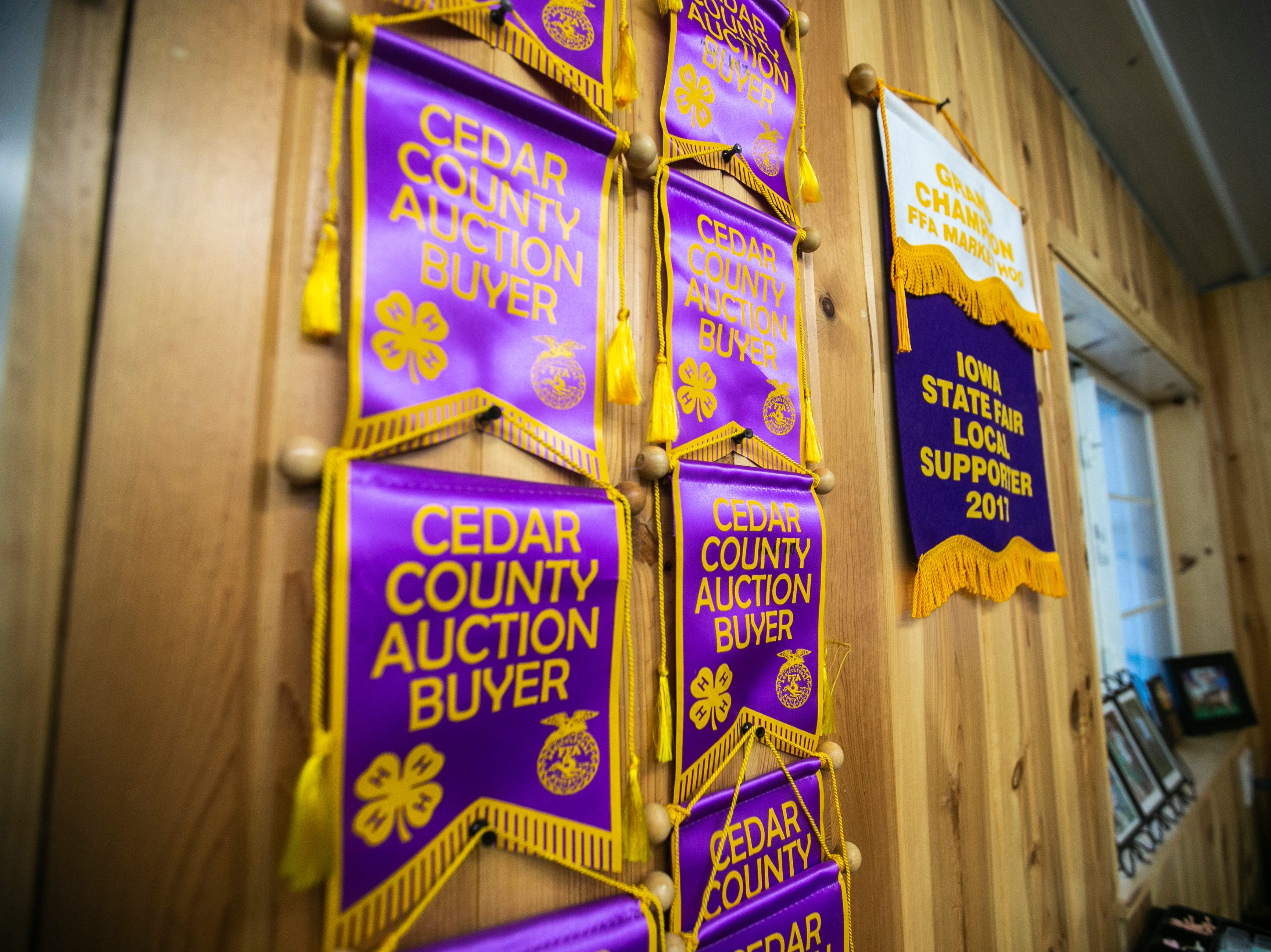 Cedar County auction ribbons hang in an office on Thursday, Jan. 17, 2019, at Natural Oak Pork farm in West Branch, Iowa.